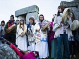 hundreds of druids and pagans descend on stonehenge to celebrate the equinox which marks the official start of autumn