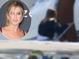 Jennifer Aniston jets out of LA as she's escapes Brangelina divorce firestorm