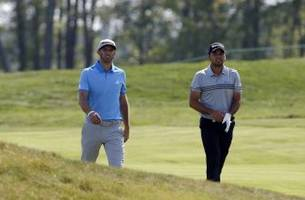 dustin johnson and jason day stick with taylormade