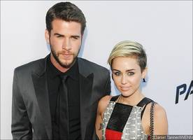 miley cyrus and liam hemsworth may put wedding on hold because of his family