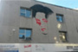 A giant mural of Elizabeth Taylor is taking shape on the side of...