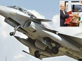 Deal sealed: Manohar Parrikar and French minister Yves Le Drian sign the 'expensive and delayed' Rs 59,000 crore Rafale fighter jet deal