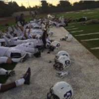 oakland high school football players lie on their backs in protest of national anthem