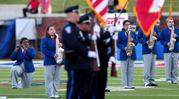 SMU band members kneel in protest during national anthem