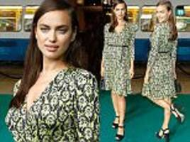 from the catwalk to the red carpet: irina shayk jets from milan fashion week to the zurich film festival as she wows in a pretty print dress at snowden film premiere