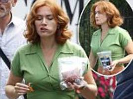 kate winslet munches on turkey jerky on the set of woody allen's latest film
