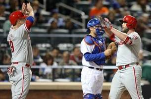 phillies blow out mets early, then hang on late