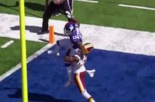 Josh Norman carries Odell Beckham Jr. out of the endzone