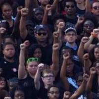 unc students protest national anthem with raised fists
