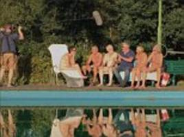 is that the new bake off line-up, paul? hollywood appears with a group of nudists after following the show to channel 4 (well, he is an expert in buns!)