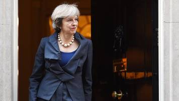 theresa may camp hits back at 'lily-livered' immigration claims