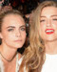 Girls just wanna have fun? Cara Delevingne and Amber Heard spark dating rumours