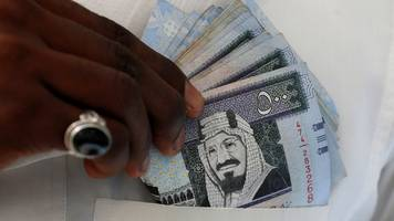 Saudi Arabia unveils first public sector pay cuts