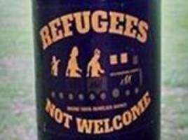 Vile stickers telling refugees they are 'not welcome' and should 'go home to Africa' are spotted around a park in Cambridge