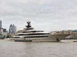 rare superyacht 'owned by billionaire fulham fc chairman' moors up on the river thames