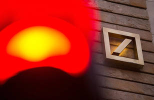 germany working on deutsche bank rescue plan as lender sells unit to shore up liquidity