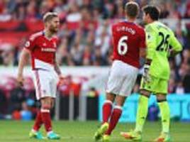 aitor karanka calls for middlesbrough players to vent in private, as victor valdes and adam clayton clash in tottenham loss