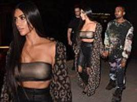kim kardashian slips into another racy outfit for paris fashion week event