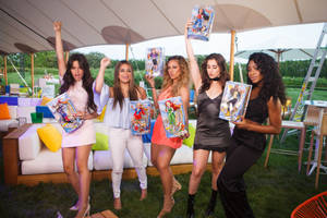 dc super hero girls teams up with pop sensation fifth harmony to empower girls