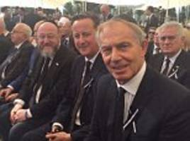David Cameron and Tony Blair sit next to each other at Shimon Peres funeral as they join 70 past and present world leaders to pay respects to historic Israeli President
