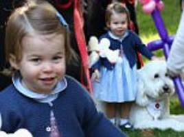 Princess Charlotte bounces excitedly on a dog at Canadian children's party
