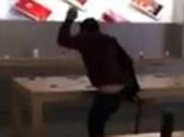 French man walks into Apple store and smashes every iPhone7 in sightin bizarre video