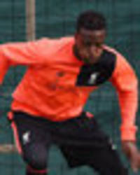 Snapped: Injured striker trains with Liverpool… will he be fit for Swansea clash?