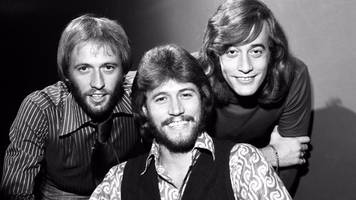 bee gee barry gibb still 'hears and sees' his late brothers