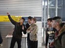 child refugees pose for selfies as they prepare to leave calais for the uk