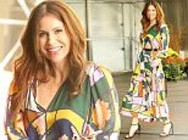 minnie driver flaunts her curves in eye-catching maxi dress out and about in new york