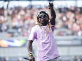 lil wayne was saved by a white cop when he was 12-years-old