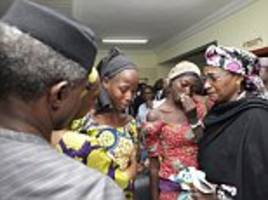 Pictured: Tearful Chibok schoolgirls released from their Boko Haram captors after two years are seen for the first time as they are hugged by the Nigerian vice president and his wife