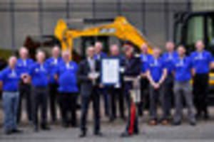 watch: production  is halted as jcb thanks workers after winning ...