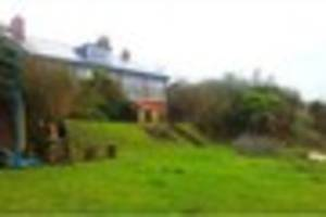 Riverside home with stunning views now owned by squatters who...