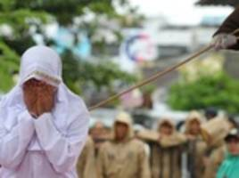 Muslim woman is caned 23 times in Indonesia for 'standing too close to her boyfriend'