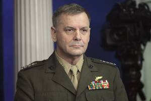 former general charged with false statements in leak probe