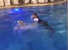 shocking moment bride almost drowns after she jumps into a swimming pool and gets weighed down by her wedding dress