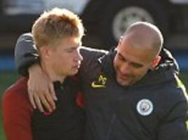 Pep Guardiola aims playful kick at Kevin De Bruyne before giving him a hug as Man City gear up for Barcelona