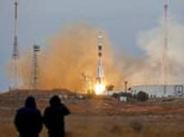 soyuz rocket carrying crew of 3 russians and 1 american blasts off from baikonur
