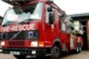 Person treated for burns after fire rips through garage  in...