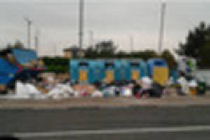tesco carnage! residents' waste swamps recycling point at...