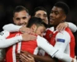 ozil celebrates first ever hat trick with special arsenal photo