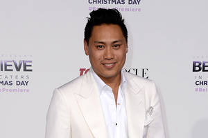 'crazy rich asians' goes to warner bros.