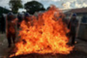 Avon & Somerset Police officers engulfed in flames as they...