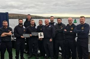 faslane's royal navy divers pay a special tribute to 834 war victims