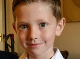 'Appalling' driver who ran over and killed his neighbour's only son, five, while telling off a girl for playing in his driveway is jailed for two years