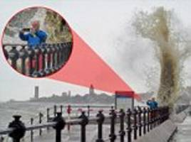 photogrpaher norman ord almost washed away by massive wave in merseyside