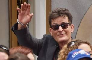 charlie sheen won't throw first pitch in world series