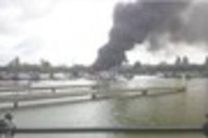 One man unaccounted for as four boats sink after fire at Barton...