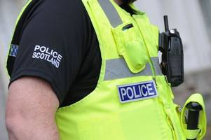 two men hunted by police after armed robbery at bookies